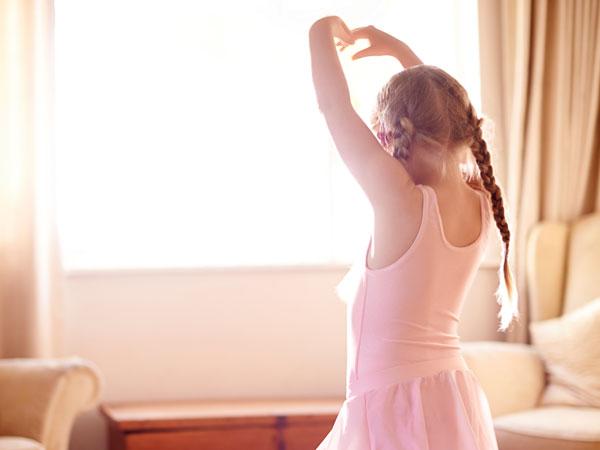 GS series girl dancing in front of window